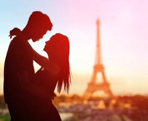 35268614 - silhouette of romantic lovers with eiffel tower in paris with sunset