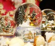 """TO GO WITH AFP STORY """"Lifestyle-Christmas-Austria-snowglobes"""" FEATURE by Sim Sim WissgottThis picture taken on December 10 shows snowglobes are displayed at a stall in the Vienna """"Christkindlmarkt"""" christmas market. Whether it's snowing or not, winter is never far away with a snowglobe in hand -- and it's a small Viennese firm that claims to have invented this trinket, supplying even Hollywood and the White House. AFP PHOTO/DIETER NAGL (Photo credit should read DIETER NAGL/AFP/Getty Images)"""
